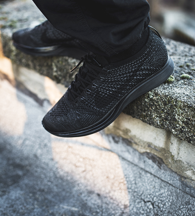 Back in Triple Black  The Nike Flyknit Racer Midnight - The Drop Date 4ea70e621