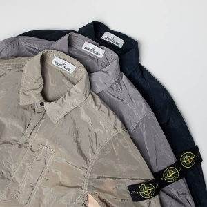 The STONE ISLAND NYLON METAL WATRO OVERSHIRT laughs in the face of unpredictable meteorological conditions, and it looks good too. Click the pic to shop.