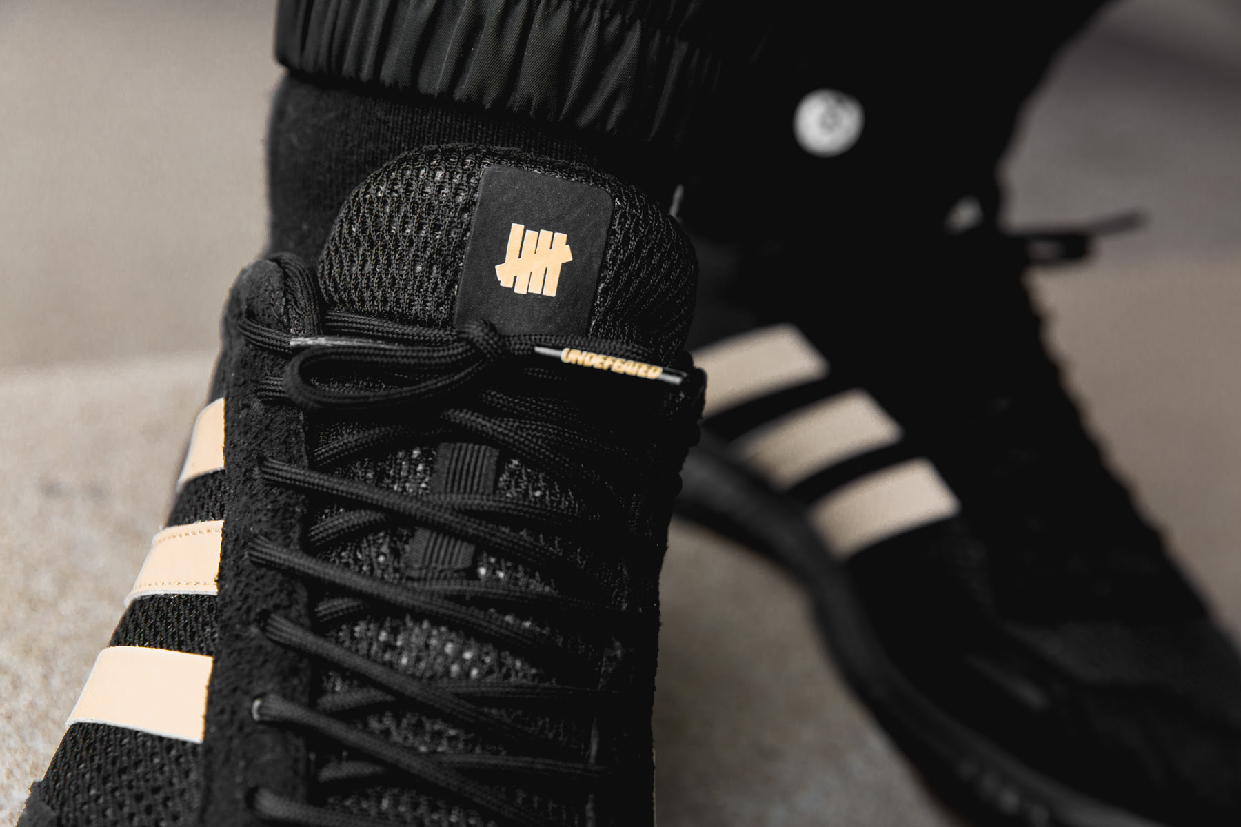 7f2fac5bc7a9 Take a Closer Look at the adidas x Undefeated Boost Pack with ...