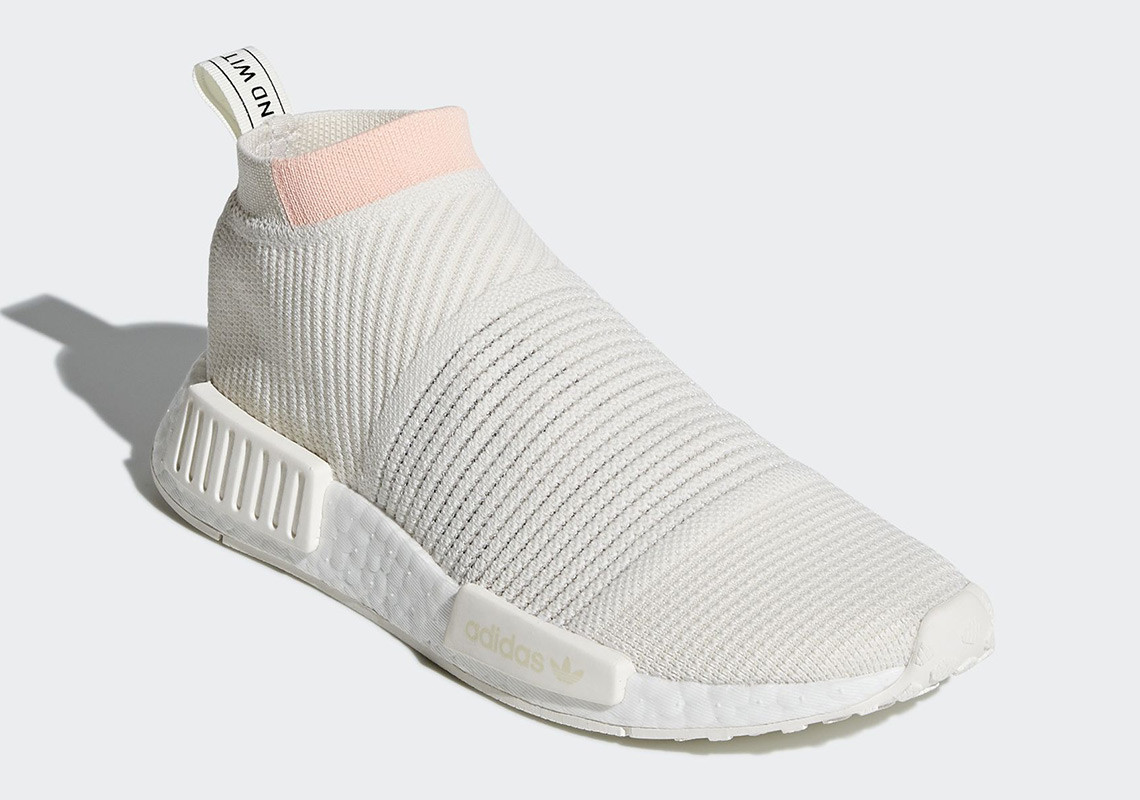 238bf4f8dc8df The ADIDAS NMD CS1 RUNNING WHITE   CLEAR ORANGE utilises a Primeknit-infused  upper and sock-like ankle collar to create the perfect slip-on for the  summer ...
