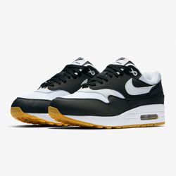 61e9e14f519021 The Nike Air Max 1 Black and White is Finished with Gum Outsoles