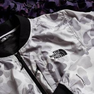 THE NORTH FACE drops a clean white camo bomber with WindWall technology to protect you against hurricanes and unwanted gas emissions. Click to shop.
