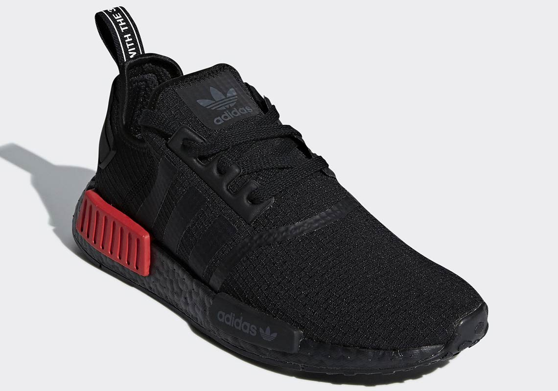 adidas turns to the dark side with the introduction of the ADIDAS NMD R1  BLACK   RED. 0032c68b5