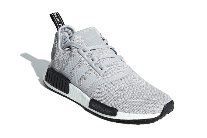 a483b5e6e11e9a Stay Stealthy with the adidas NMD R1 Camo Heels - The Drop Date